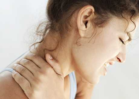 Young Woman Holding Her Neck in Pain